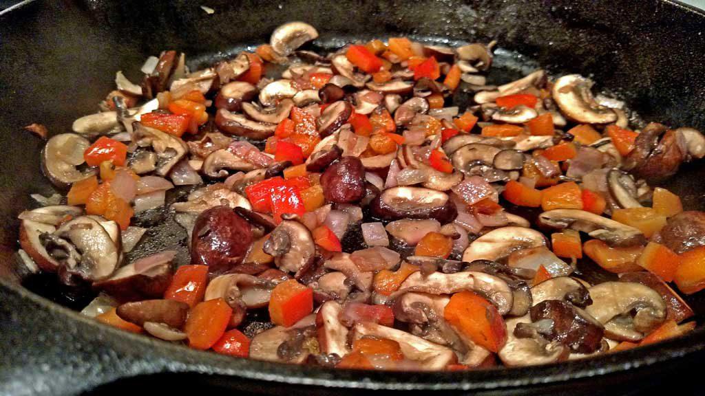 vegetables sauteing in pan