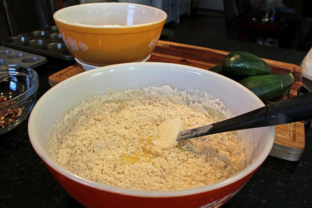zucchini muffin batter in bowl