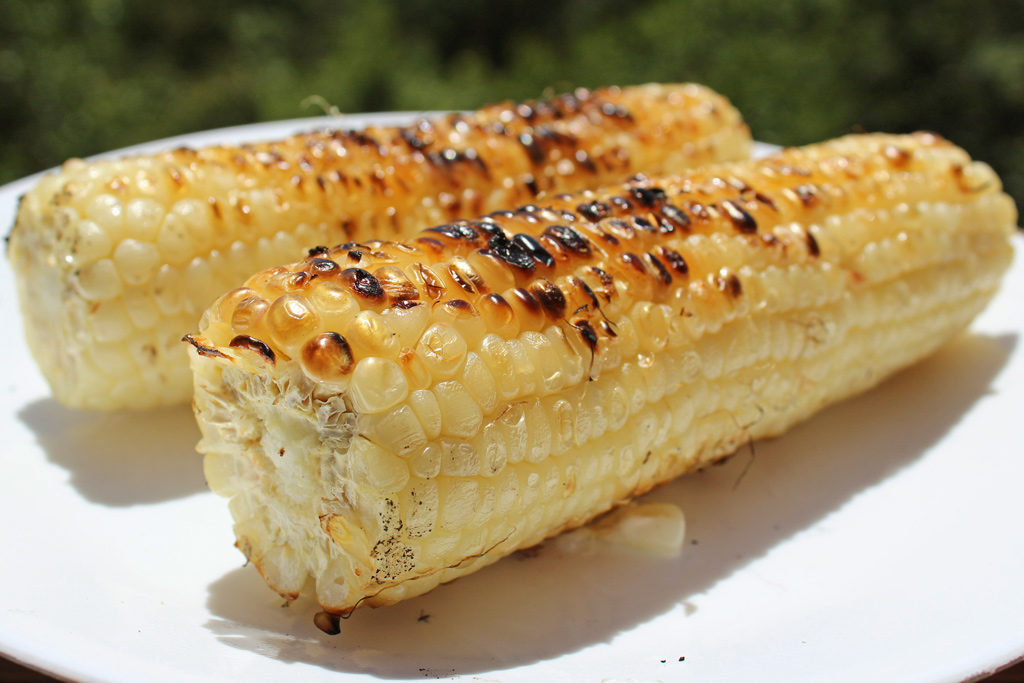 grilled corn on plate
