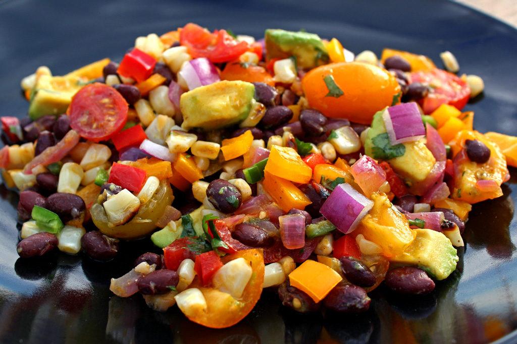 grilled corn black bean salad served on black plate