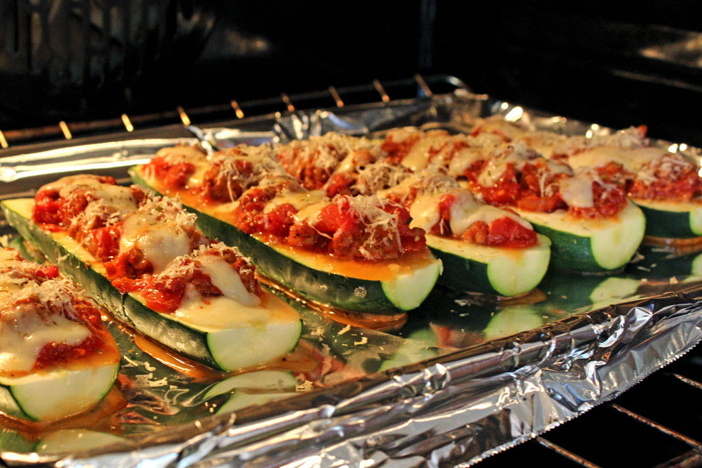 zucchini boats baking in oven