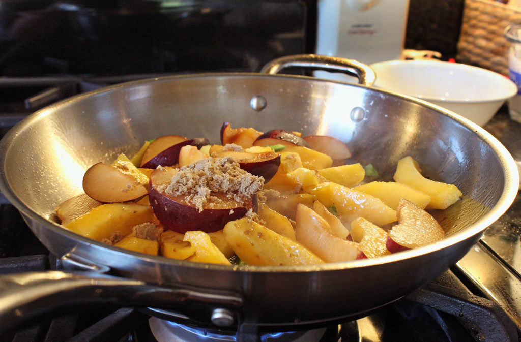 plums and peaches added to pan