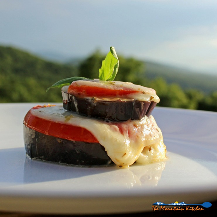 Roasted Eggplant Caprese Stacks on a plate ready to eat with mountain view
