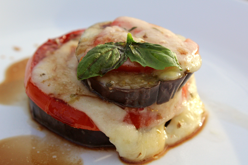 Roasted Eggplant Caprese Stacks are made with fresh basil, melted mozzarella, roasted tomatoes and eggplant slices, drizzled with balsamic vinegar and extra-virgin olive oil.   TheMountainKitchen.com