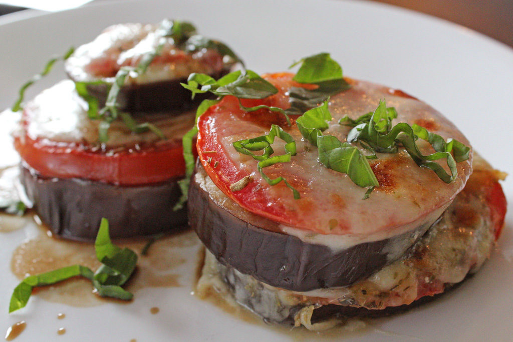 Roasted Eggplant Caprese Stacks on a plate read to eat
