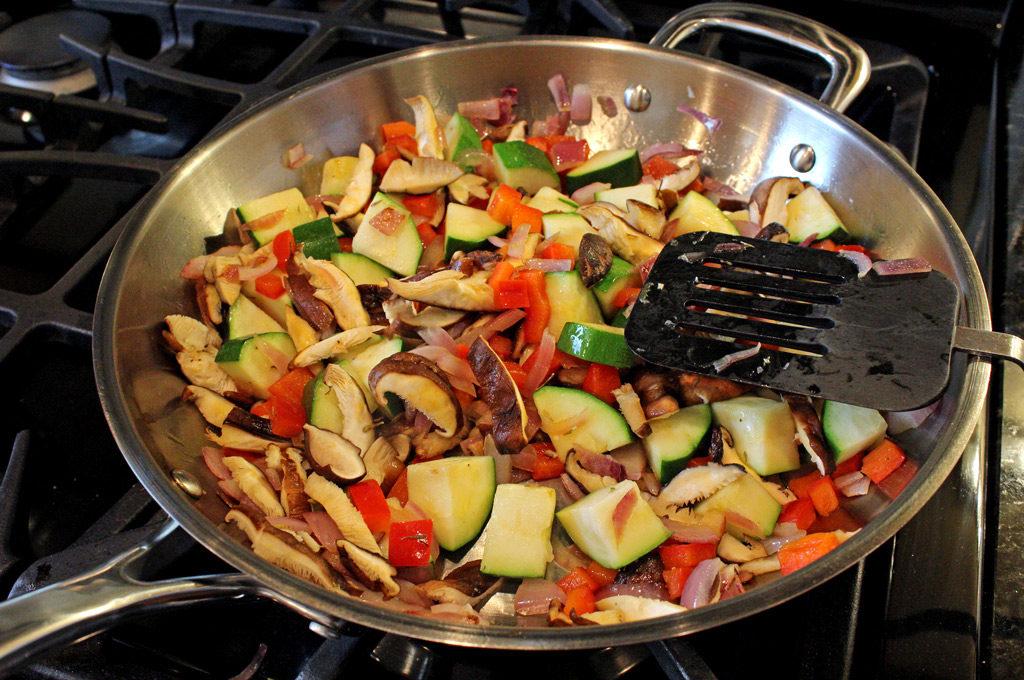 vegetables in pan sautéing