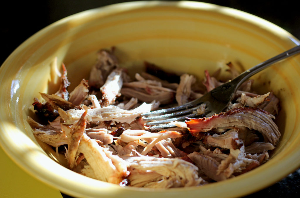 shredded pork in bowl with fork