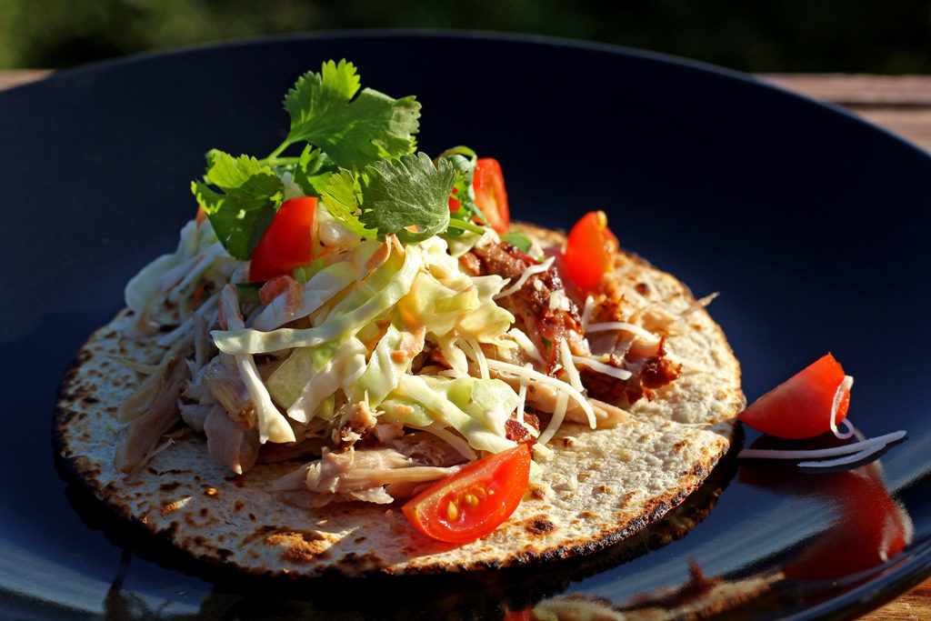 Applewood Smoked Pork Carnitas with Spicy Cabbage Slaw served on a plate
