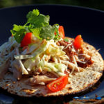 Applewood Smoked Pork Carnitas with Spicy Cabbage served on a tortilla