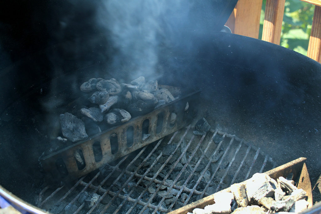 charcoal smoking in charcoal basket