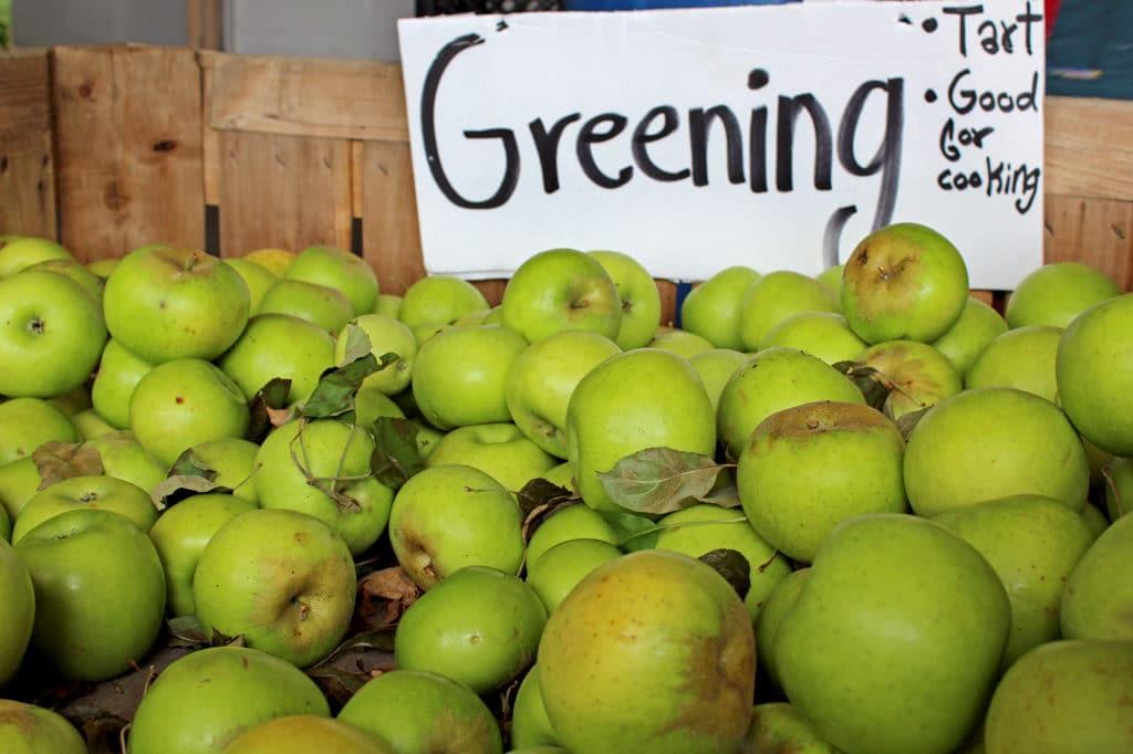 crate of greening apples