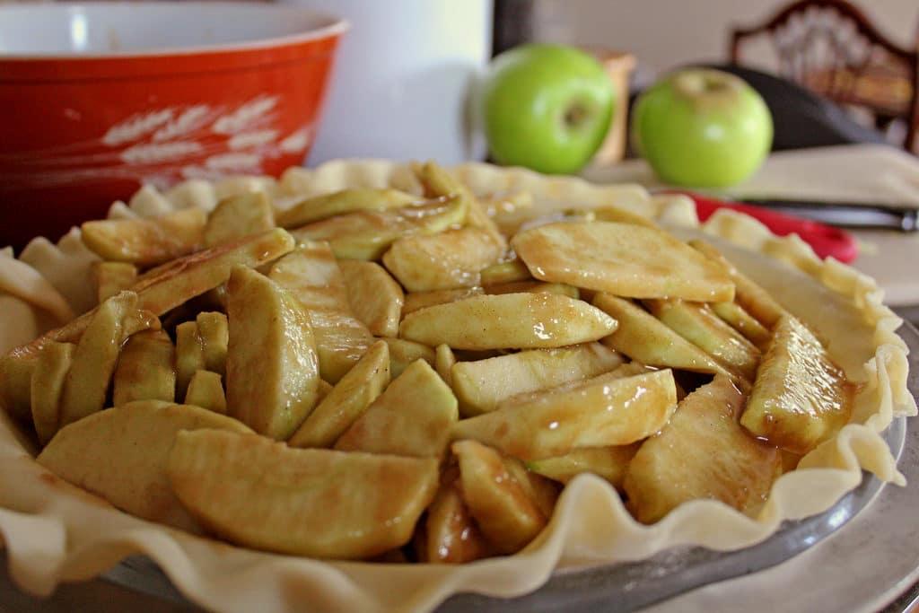apples sliced inside pie dough