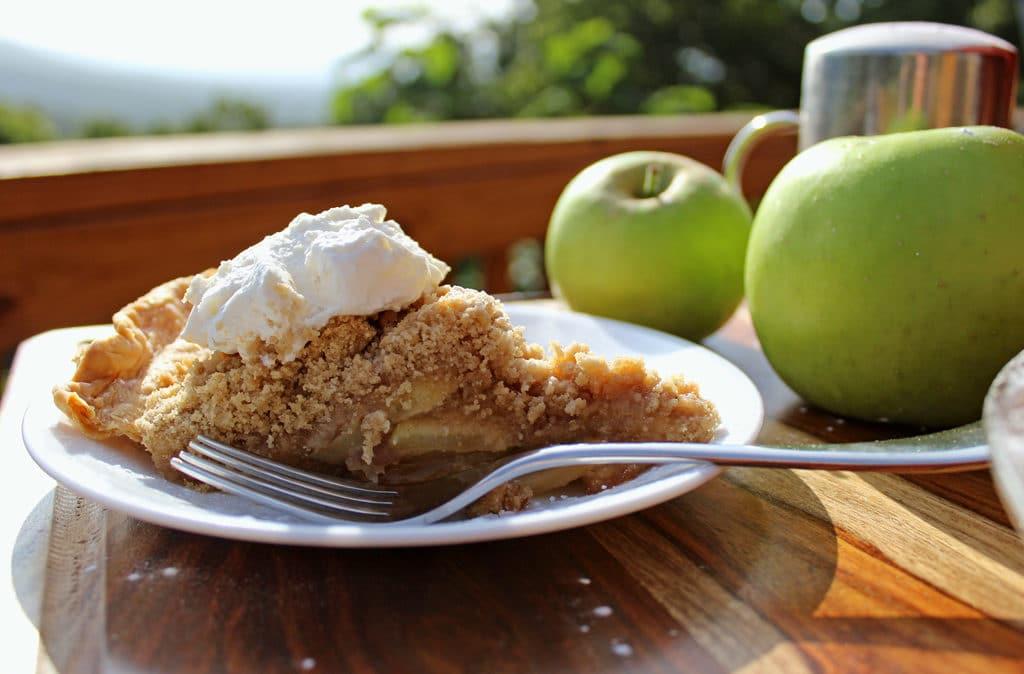 slice of apple crumb pie ready to eat