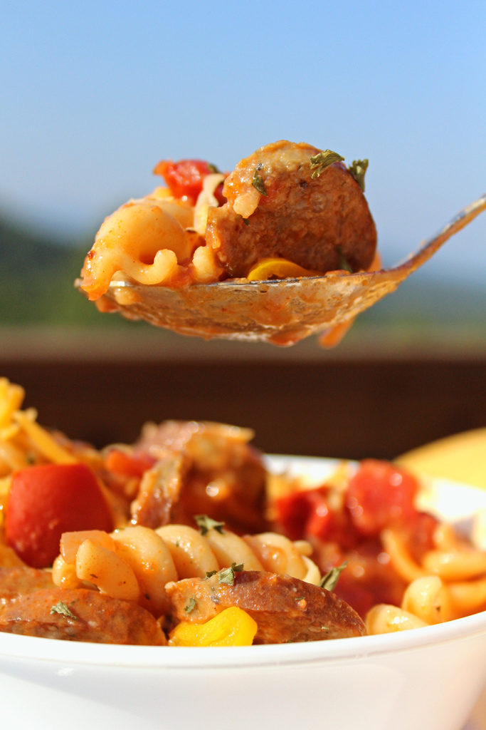 spoonful of Cajun Pasta with Andouille Sausage and mountain view