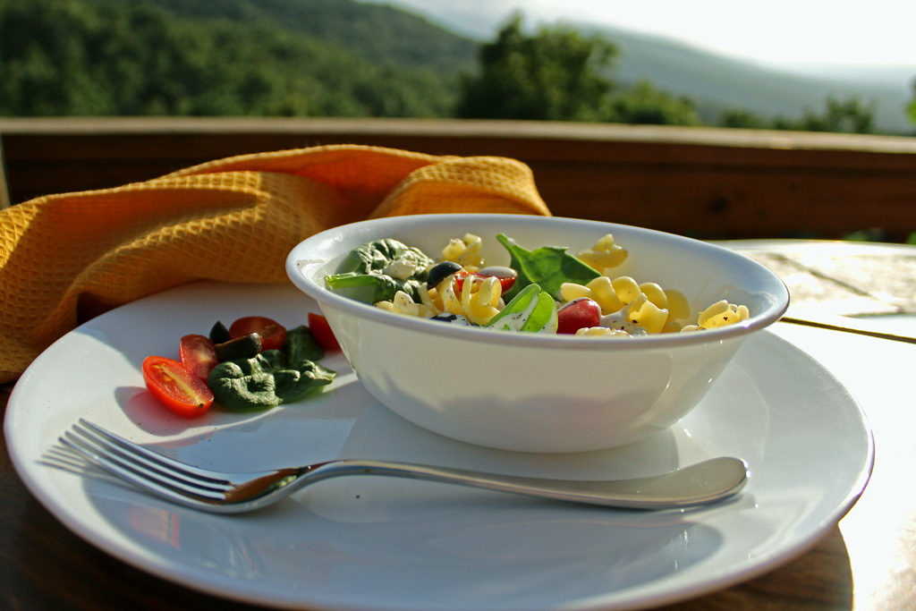 a bowl of pasta salad with mountain view