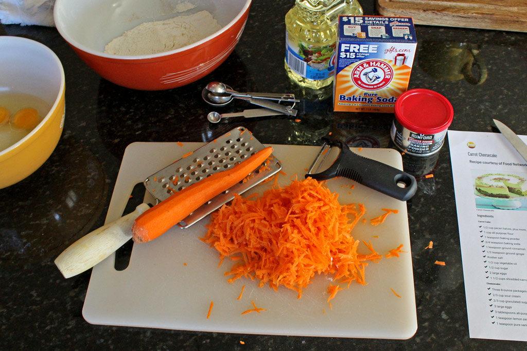 Shredded carrots on a cutting board.