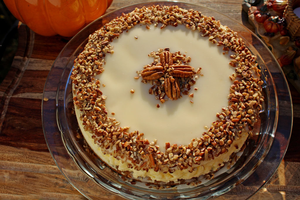 Carrot Cake Cheesecake is a great recipe mash-up. Cream cheese frosting is the best part carrot cake, so why not bake a cheesecake on top of a carrot cake? | TheMountainKitchen.com
