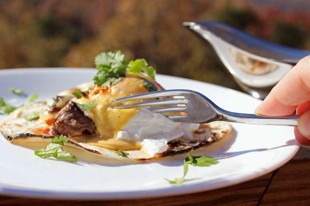 slicing into steak eggs benedict