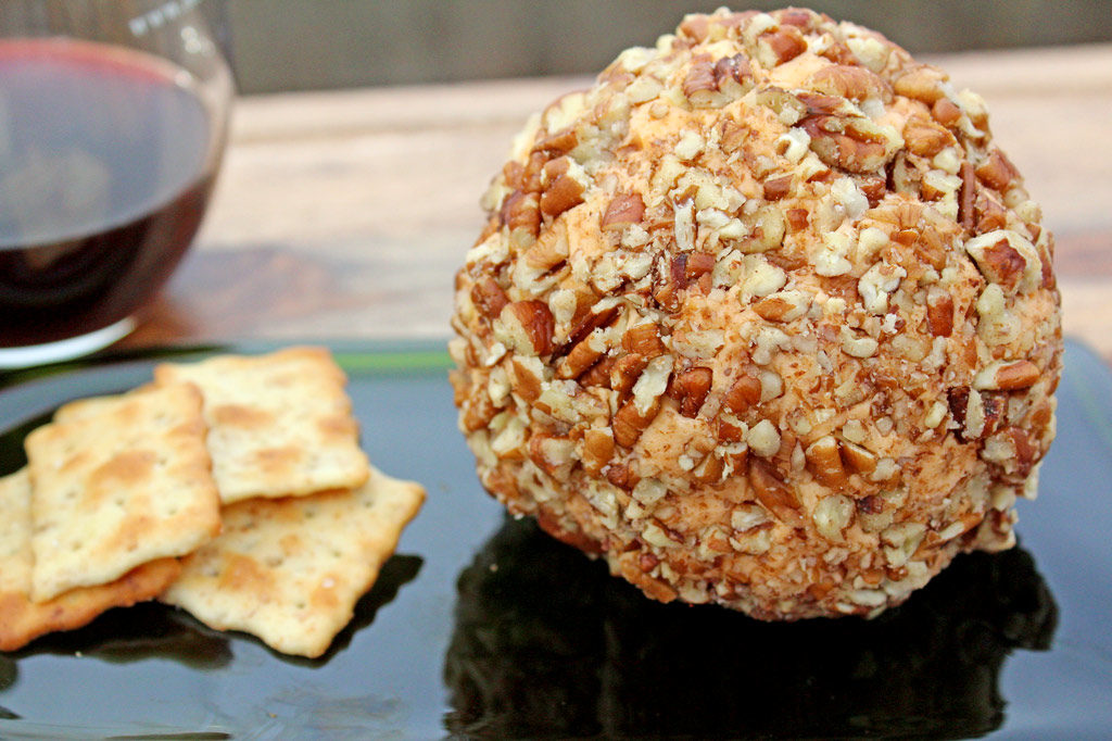 Mama's Christmas cheese ball with crackers and wine