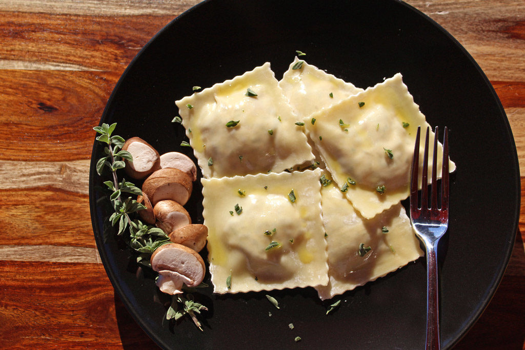 Mushroom and sun-dried tomato ravioli made with wonton wrappers stuffed with mushroom sun-dried tomato cheese filling and a delightful lemon butter sauce. | TheMountainKitchen.com