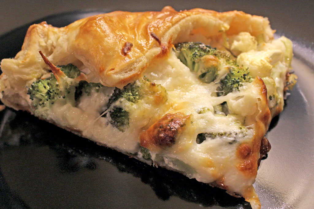 This savory broccoli-cauliflower galette is made with leeks, garlic and ricotta cheese inside a rustic buttery pastry crust.