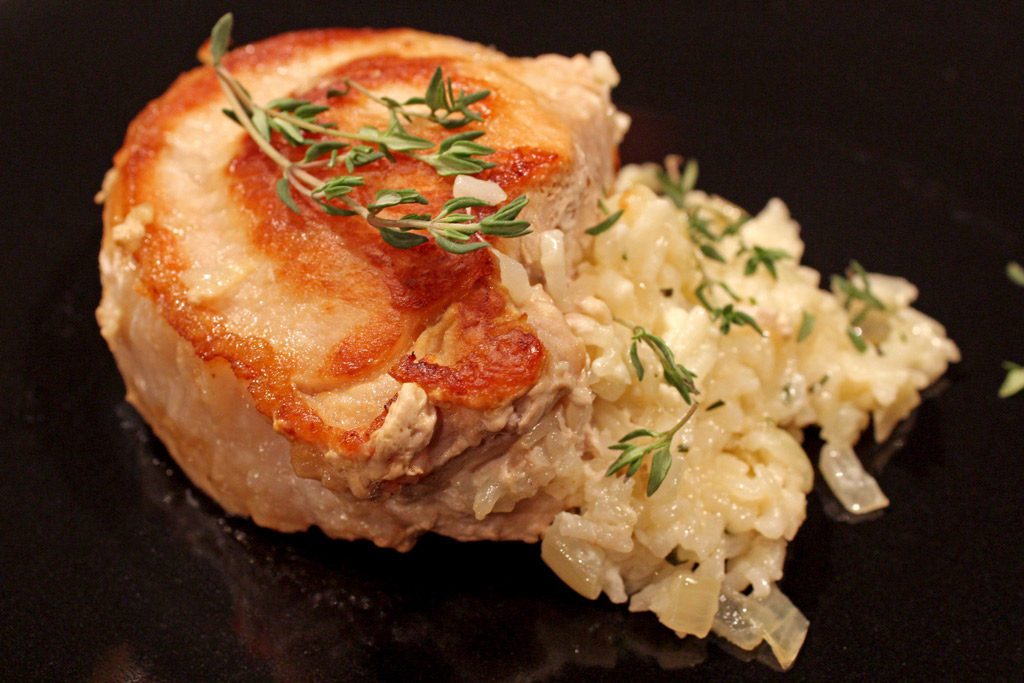 These cheesy rice stuffed pork chops are made with juicy pan seared pork chops stuffed with creamy rice with mozzarella, ricotta and parmesan cheeses. YUM! | TheMountainKitchen.com