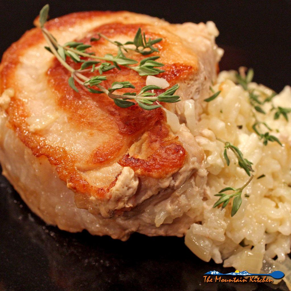 Cheesy rice-stuffed pork chops are juicy pan-seared pork chops stuffed with creamy rice with mozzarella, ricotta, and parmesan cheeses.