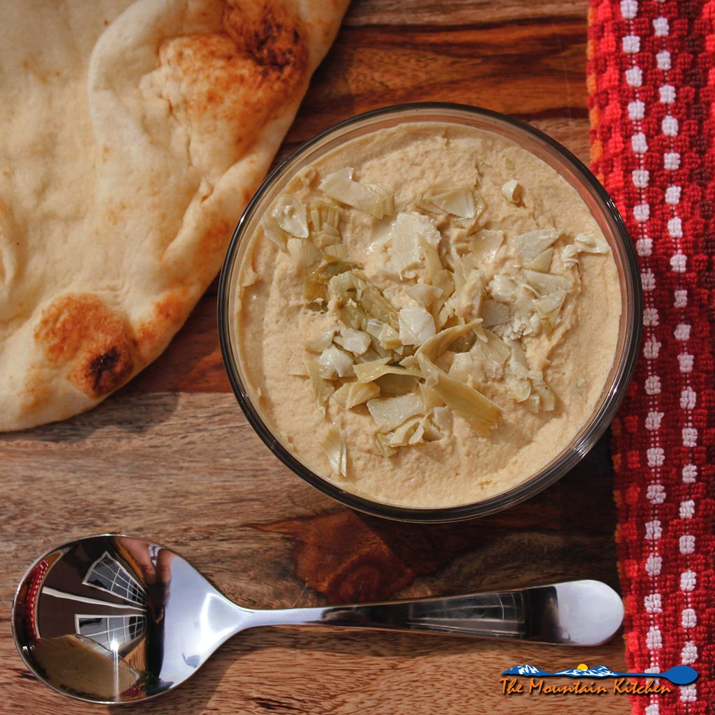 Marinated Artichoke Hummus is a delicious appetizer or snack. The artichokes offer a tanginess lightens the denseness that hummus can have.