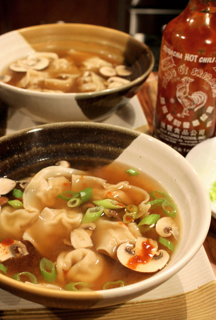 Wonton soup is made of dumplings filled with seasoned ground pork, soy sauce, rice vinegar, and ginger, gently simmered in ginger broth.