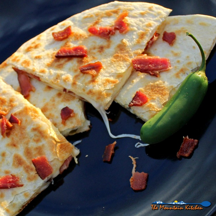 Bacon cheese and jalapeno quesadillas are made with smoky bacon, creamy and gooey Monterrey Jack cheese and spicy jalapenos in a tortilla blanket of love. | TheMountainKitchen.com