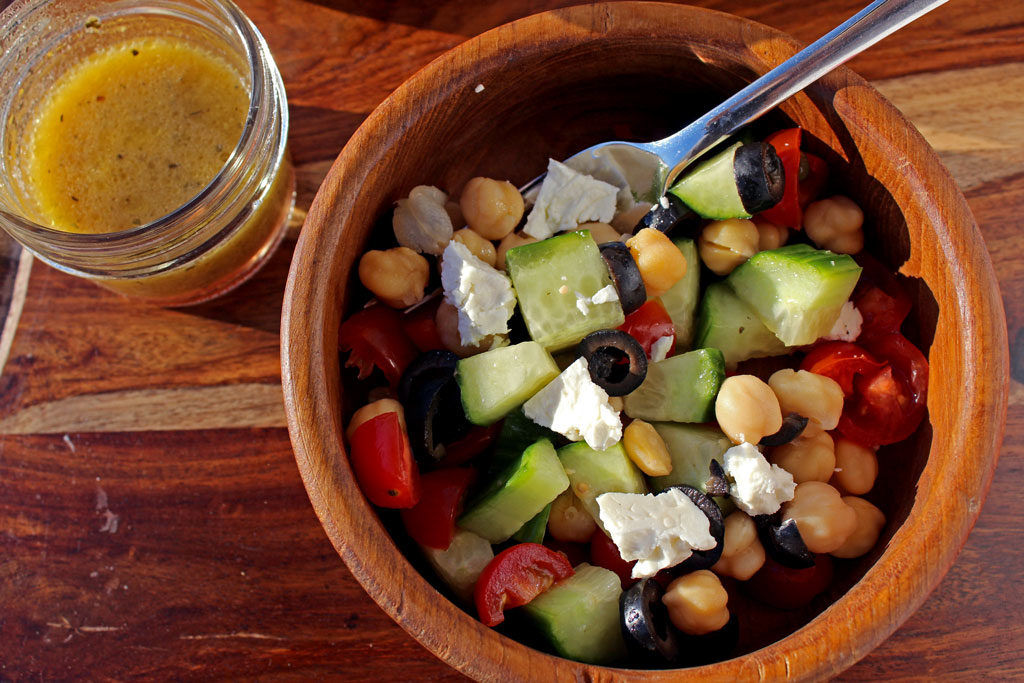 This amazing Greek Chickpea Salad is healthy light and fresh and is loaded with protein packing chickpeas, that will leave you feeling fuller longer. Tasty! | TheMountainKitchen.com