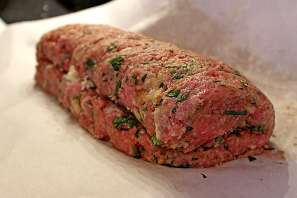 rolled raw meatloaf ready to bake