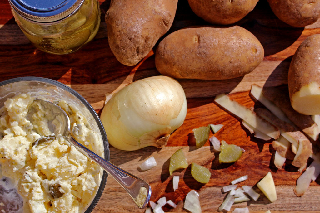 This crowd pleasing potato features bite-sized potatoes and chopped sweet pickles and onion mixed with a creamy, tangy dressing, with a zippy finish. Yummy! | TheMountainKitchen.com