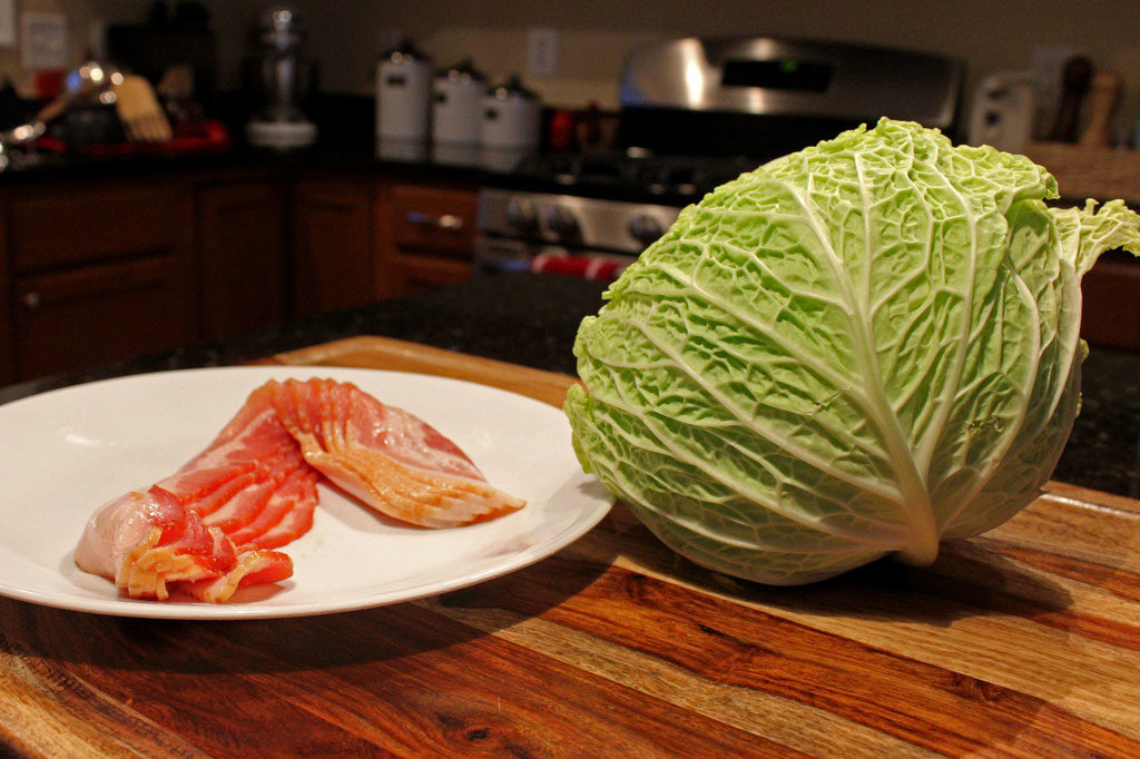 This simple recipe for bacon-fried cabbage only has 3-ingredients. The cabbage is seasoned with bite-sized bits of bacon. An easy side dish in just minutes.   TheMountainKitchen.com
