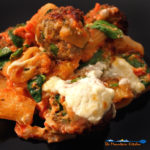 Quick and easy weeknight indulgence, this baked pasta is made with juicy meatballs in a bed of cheesy pasta with fresh spinach and creamy ricotta cheese. | TheMountainKitchen.com