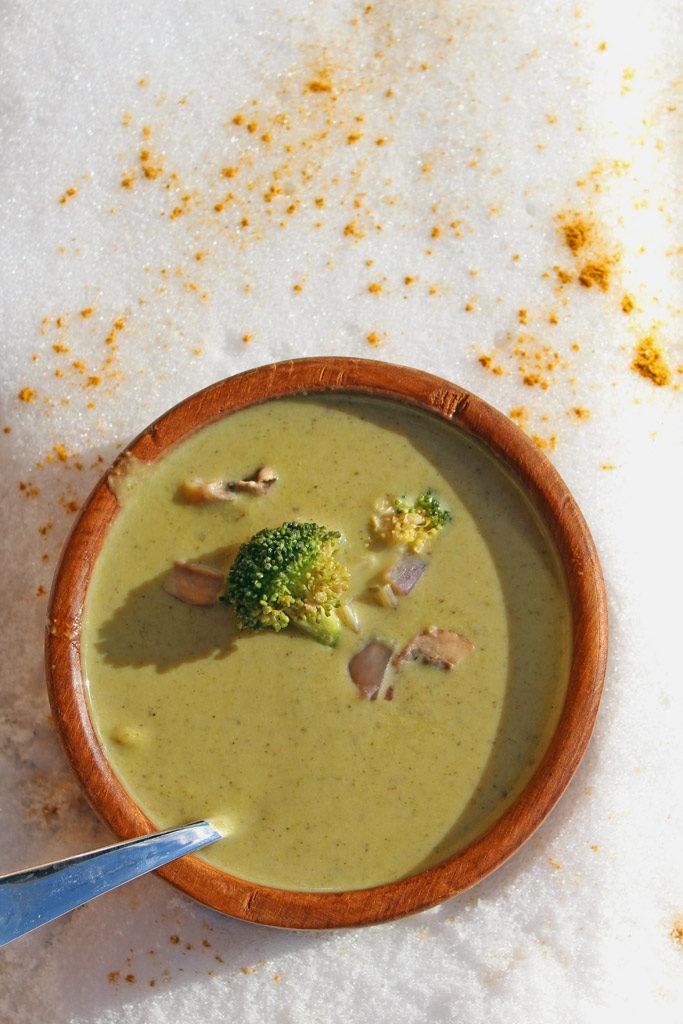 bowl of broccoli potato soup in snow