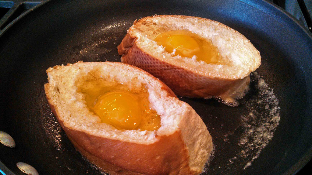 French bread with raw egg in skillet