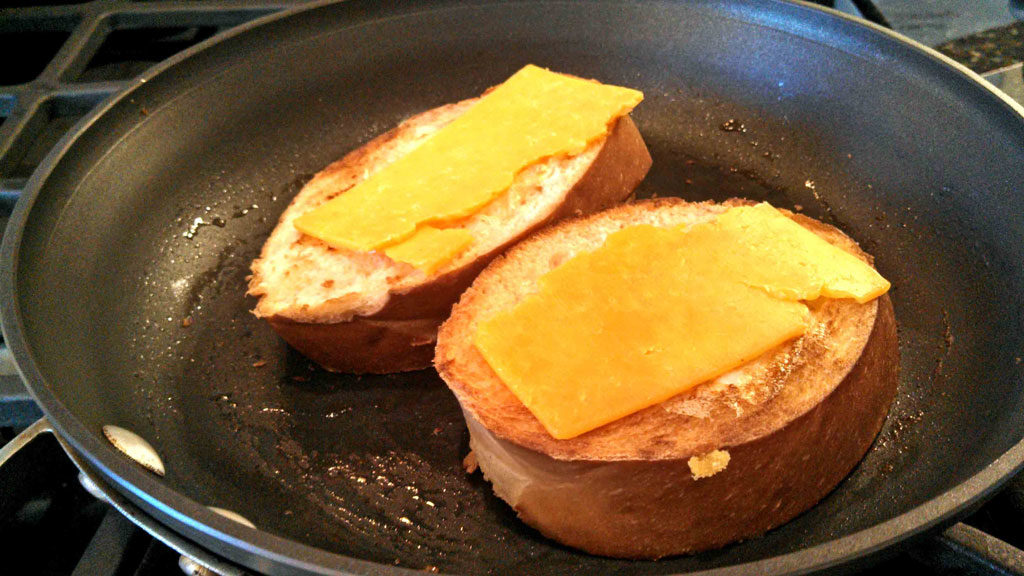 French bread egg in a basket with cheese on top
