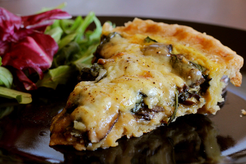 This easy to prepare Mushroom Spinach Quiche is made with mushrooms, spinach, shallots and Gruyere cheese. Great for breakfast, lunch or dinner!   TheMountainKitchen.com