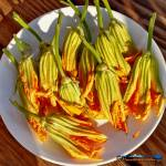 These delicate fried squash blossoms are filled with a creamy ricotta cheese mixture and dipped in a light batter, fried to a golden brown. They're amazing!