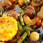 Cajun spiced shrimp, juicy andouille sausage, asparagus, potatoes and corn make up a flavorful meal in minutes. Make this Sheet Pan Cajun Dinner tonight! | TheMountainKitchen.com