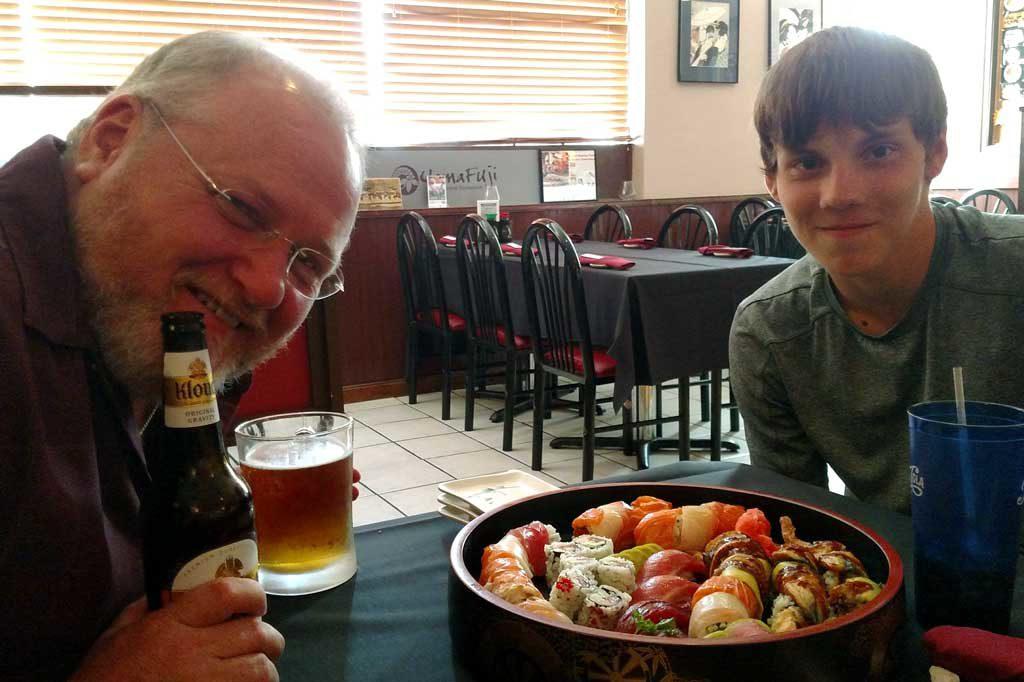 David and Seth eating sushi