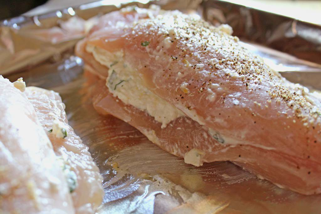 raw chicken breast smeared and stuffed with cheese filling
