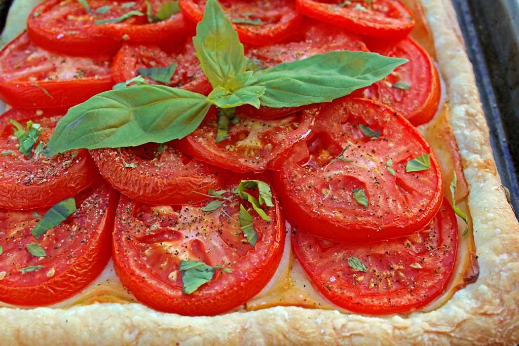 Roasted tomato cheese tart: puff pastry, ripe tomatoes Dijon mustard, smoked Gruyere cheese, simply seasoned with fresh thyme, fresh basil, salt and pepper.   TheMountainKitchen.com