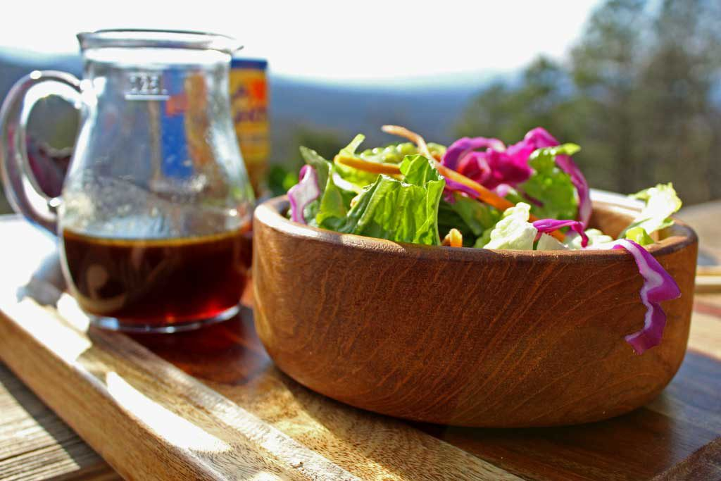 bowl of salad and dressing