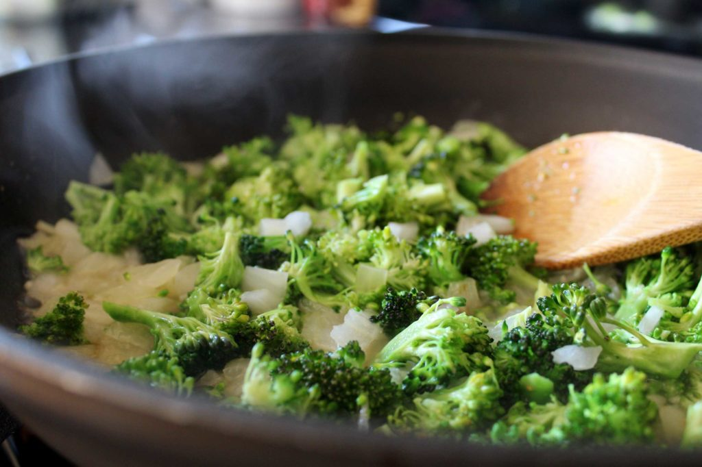 cooking broccoli and onions