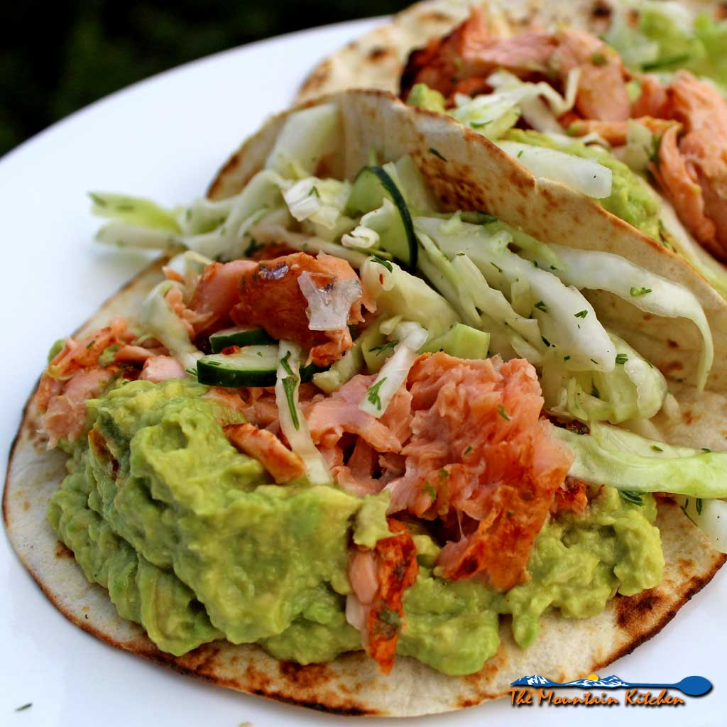 Fresh and simple, the tangy dill slaw with cucumbers adds a nice crunch, offset by smooth avocados the perfect match to the heat to Ina's salmontacos.