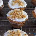 These delicious carrot cake muffins are lightly spiced and topped with cream cheese frosting and sprinkled with walnuts, an irresistible breakfast treat! | TheMountainKitchen.com