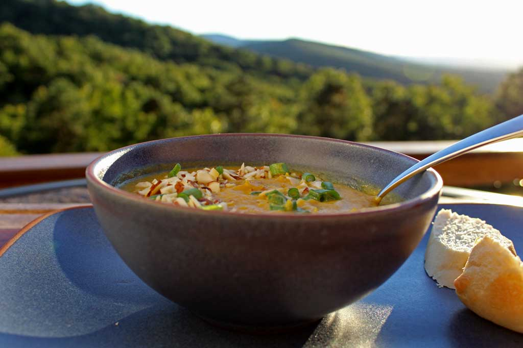 This easy vegetarian roasted pumpkin soup with almonds and sage is a creamy, velvety smooth soup, yet healthy way to start a fall dinner or as meal itself! | TheMountainKitchen.com