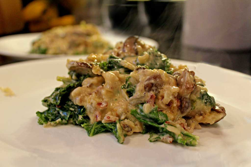 plates with kale wild rice and mushroom casserole ready to eat